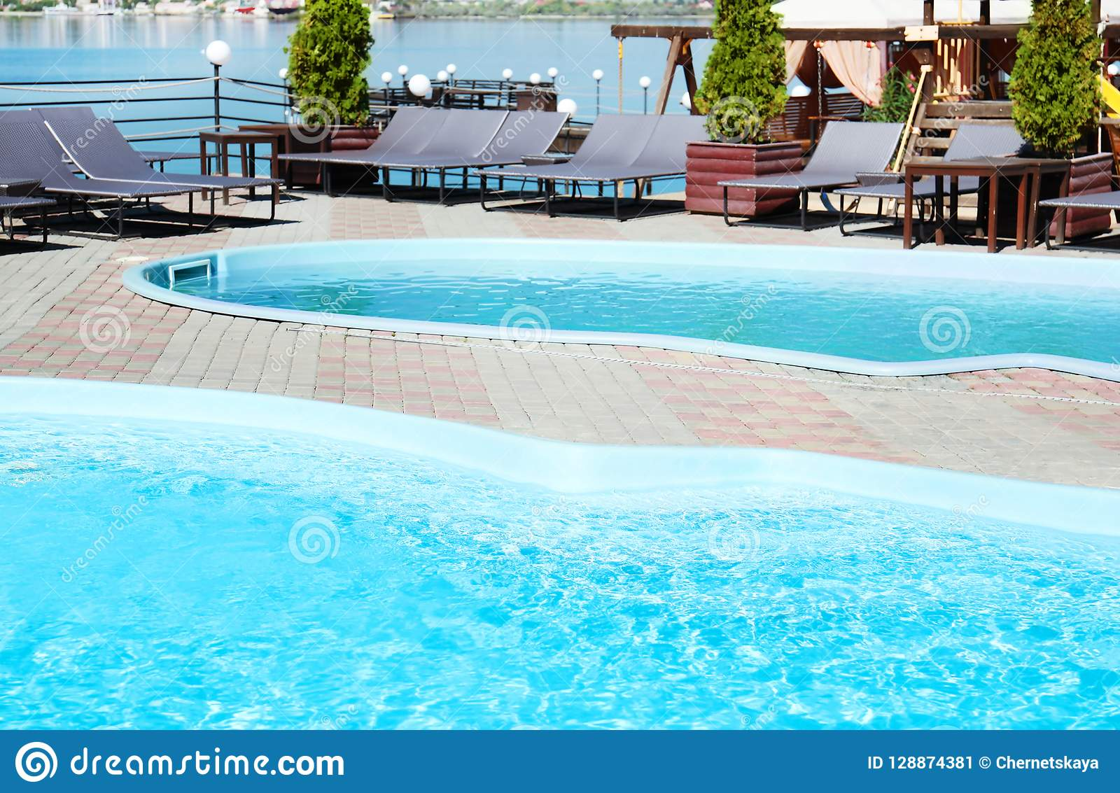 Swimming Pools With Clean Blue Water And Lounge Chairs Stock Image ...