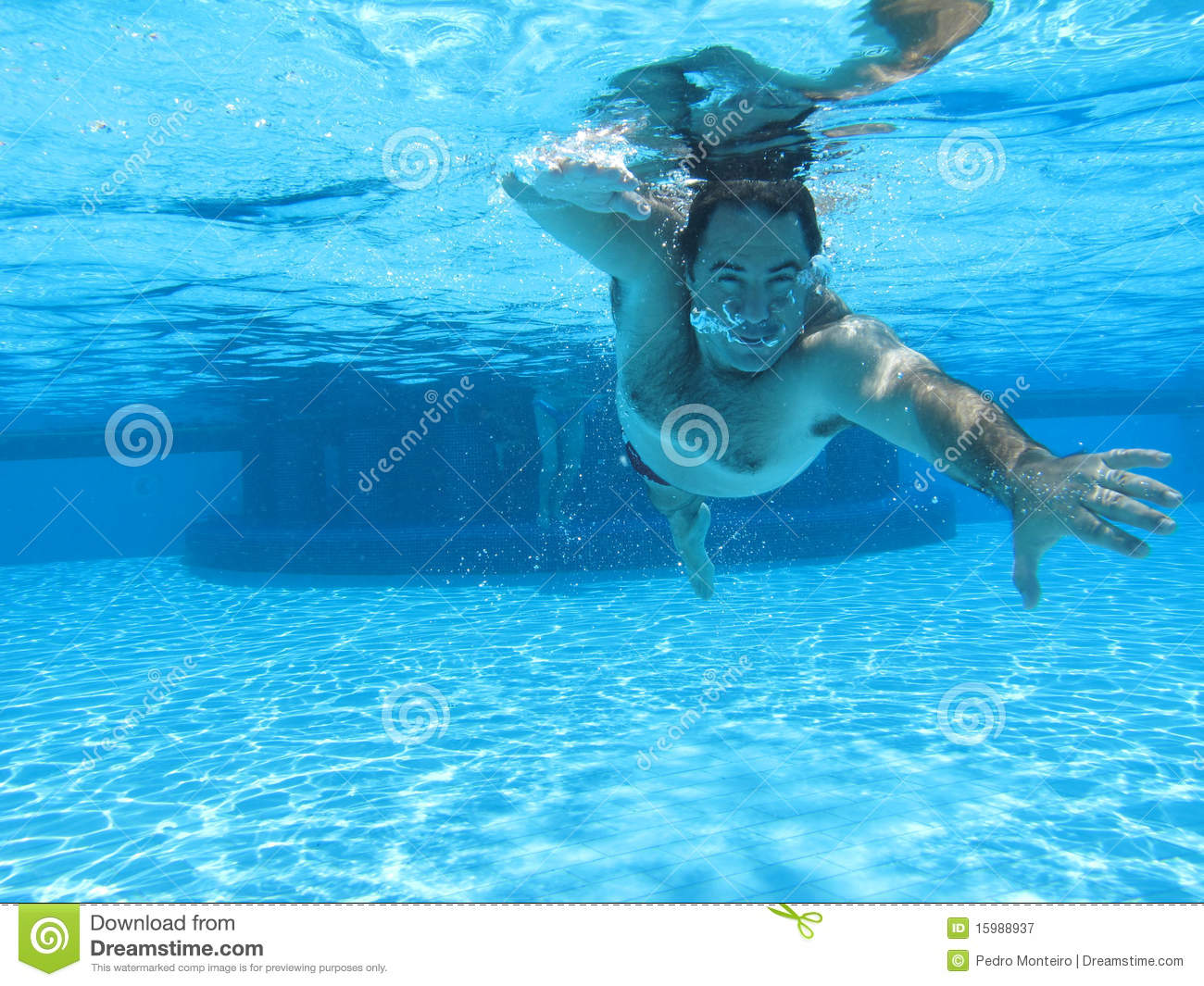Swimming underwater photo of a men
