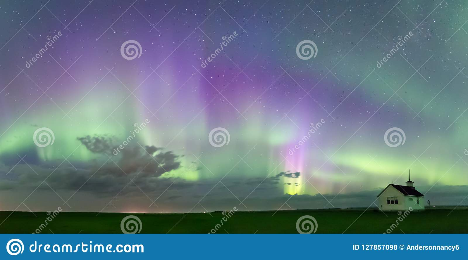 Swirl of Aurora Borealis Northern Lights over the historical North Saskatchewan Landing school