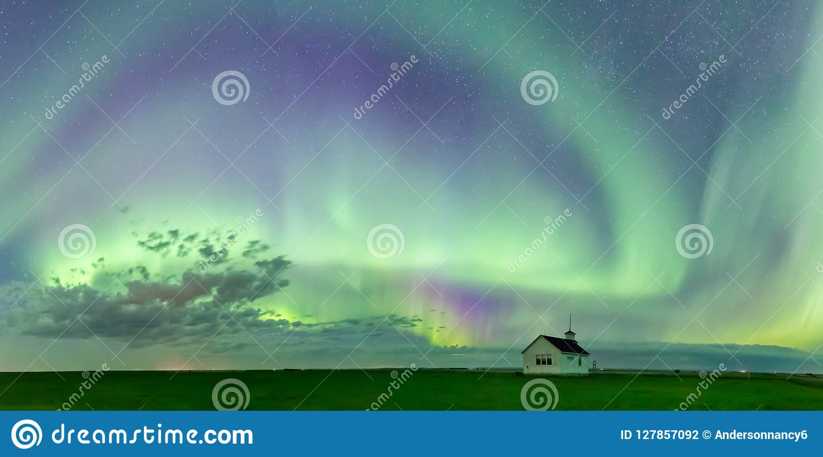 Swirl of Aurora Borealis Northern Lights over the historical North Saskatchewan Landing school