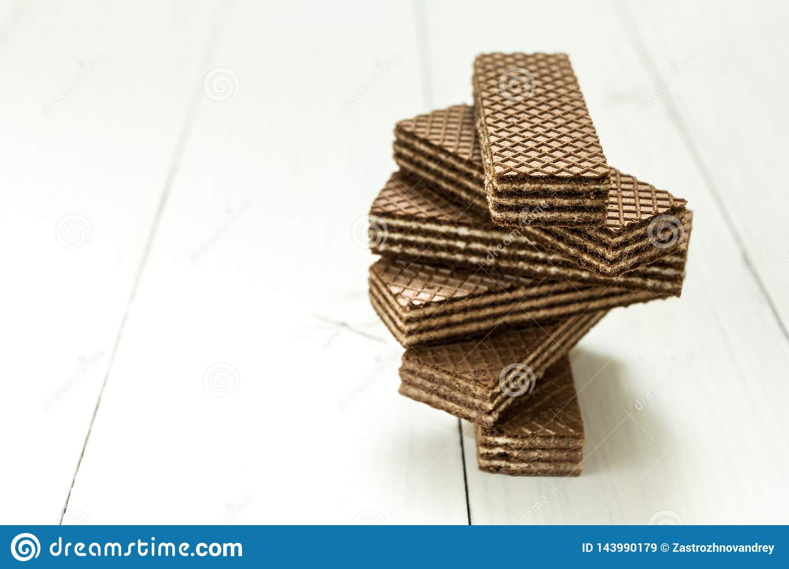 A swirling stack of chocolate wafers on a white table