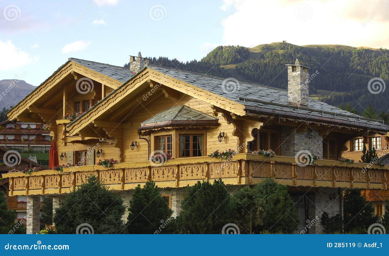 Swiss chalet in the evening sun Crans Montana Valais Switzerland.