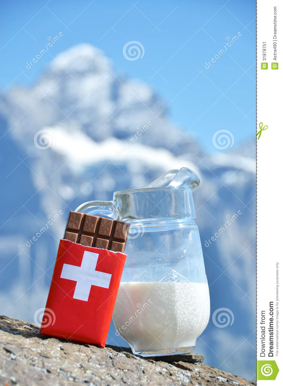 Swiss Chocolate And Jug Of Milk Stock Image - Image: 31878751