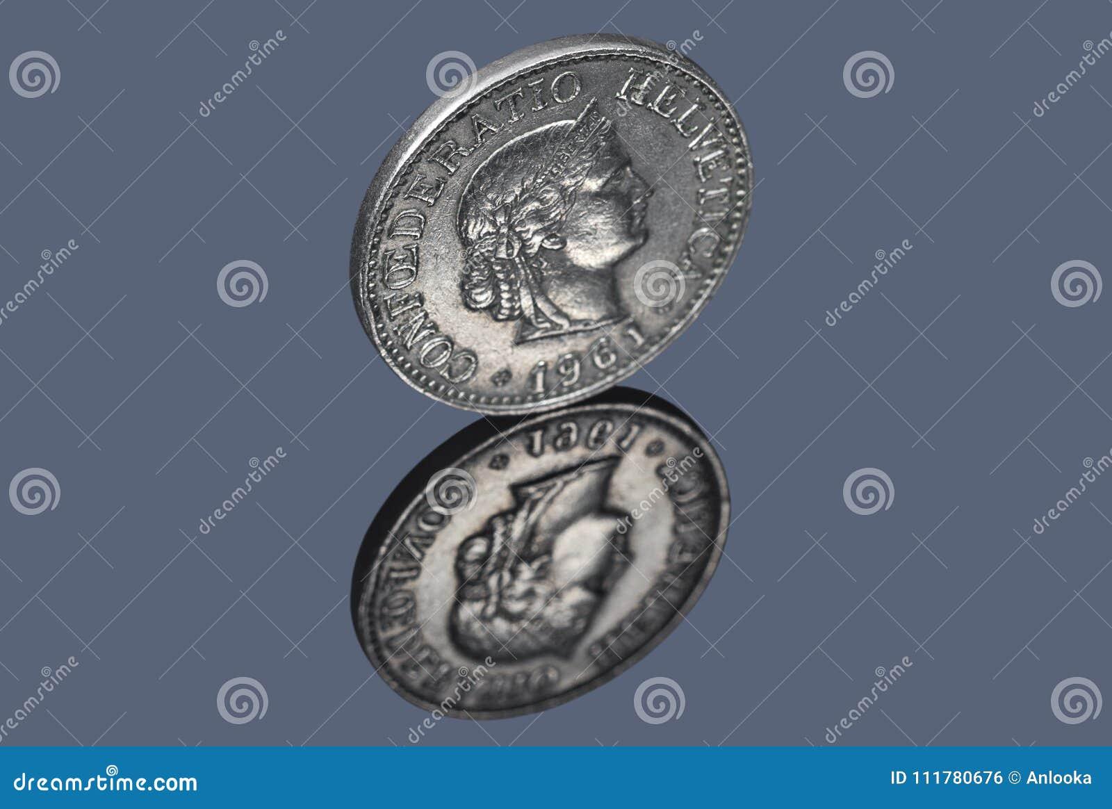 Swiss coin of ten centimes on dark background