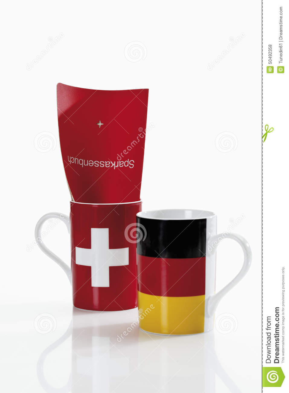 Swiss and german flag cups with bank book on white background royalty free stock photo buycottarizona Image collections