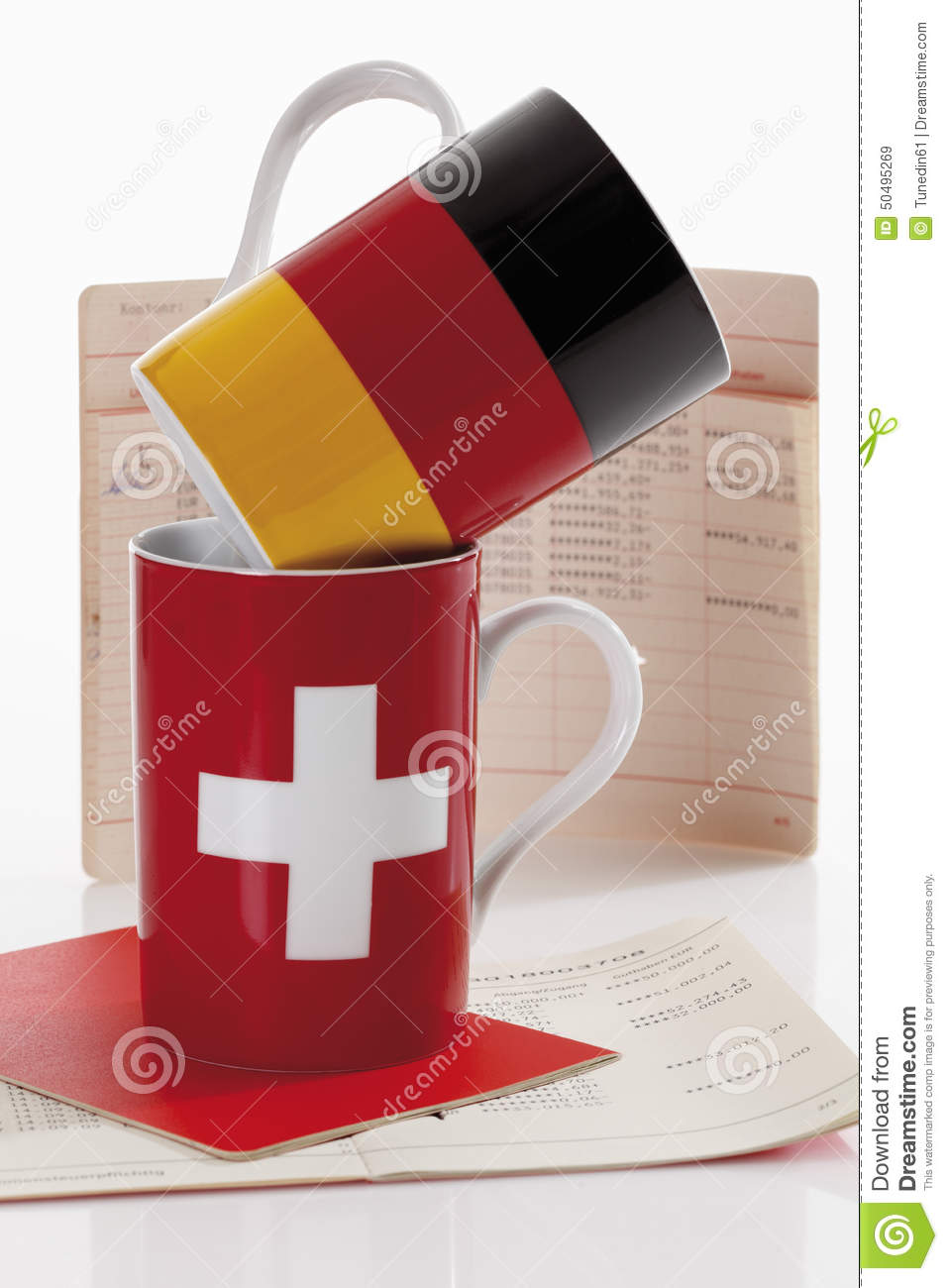 Swiss and german flag cups with bank book on white background swiss and german flag cups with bank book on white background national text buycottarizona Image collections