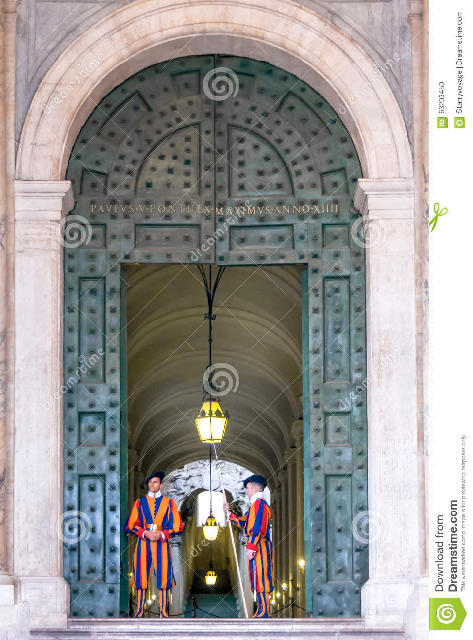 Swiss Guards Stand At The Bronze Door Of The Apostolic