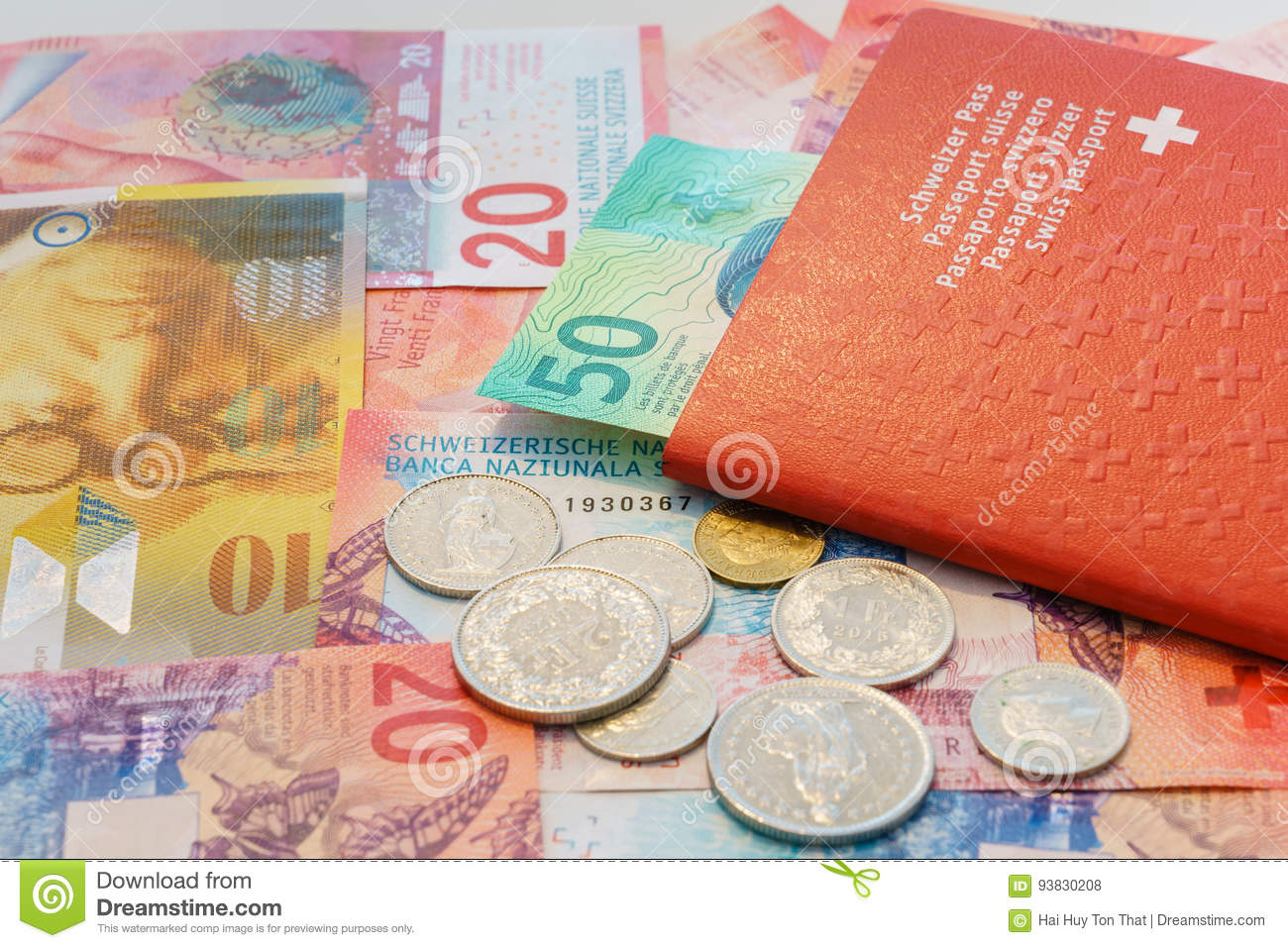 Swiss passport and Swiss Francs with New 20 and 50 Swiss Franc bills.