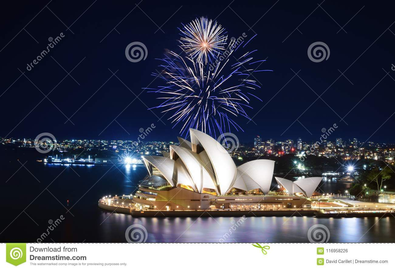 An impressive display of fireworks light up the sky in blue and white over the Sydney Opera House