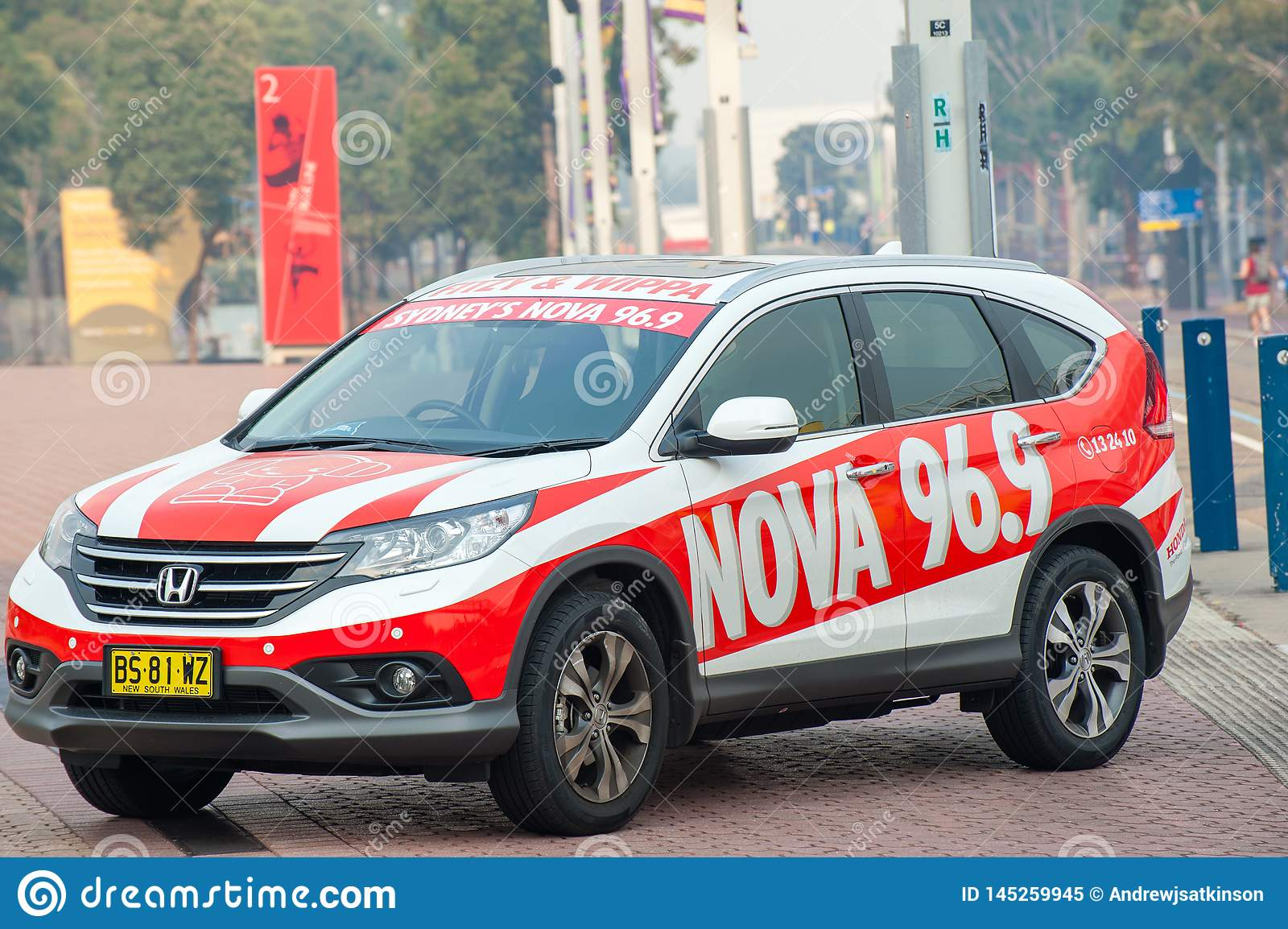 Honda car with signage for a Sydney radio station, Nova 96.9 parked at a fun running event