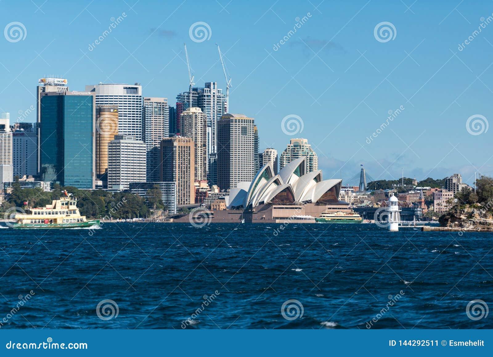 Sydney CBD and Sydney Opera House with ferry boat