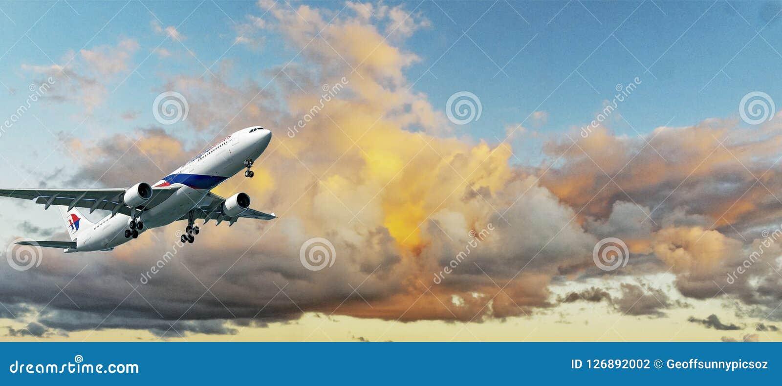 Aircraft in flight with Colourful cumulonimbus cloud in blue sky