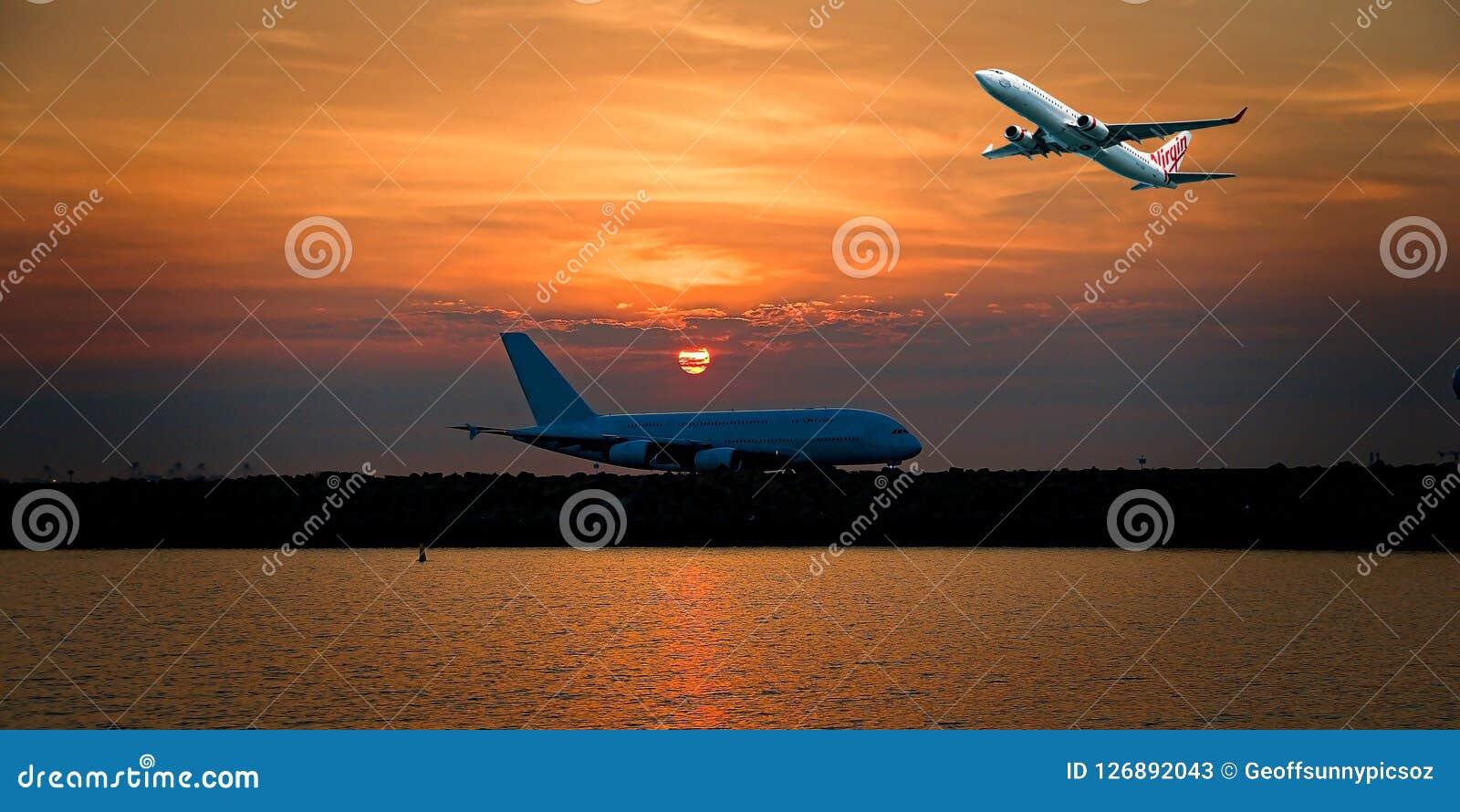 Aircraft in flight with cirrus cloud in orangge sky. Australia.