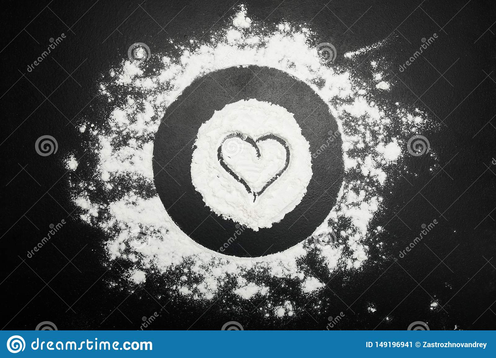 Symbol of the heart on flour