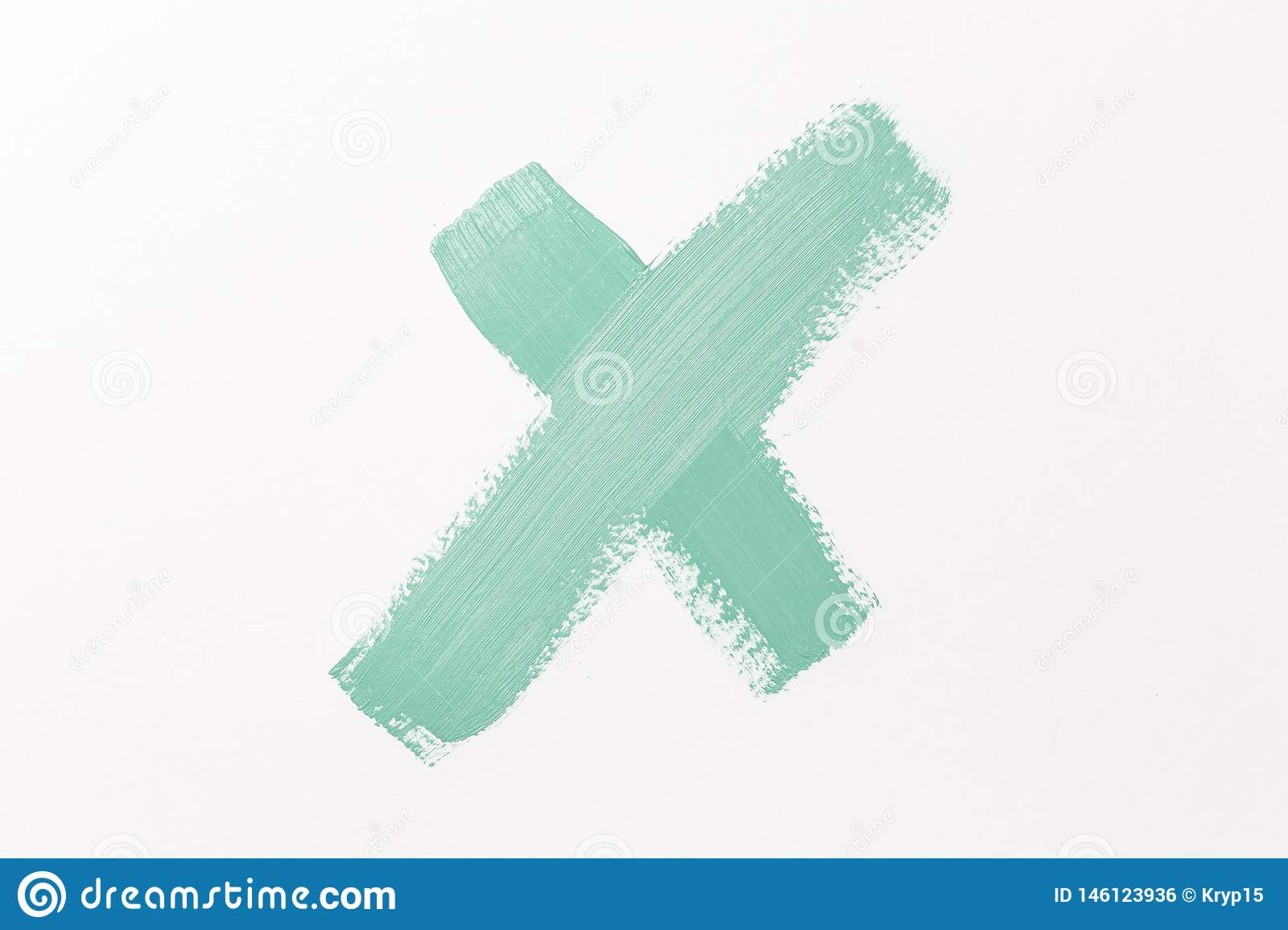 The symbol with the letter X. Abstract texture of Mint paint on paper