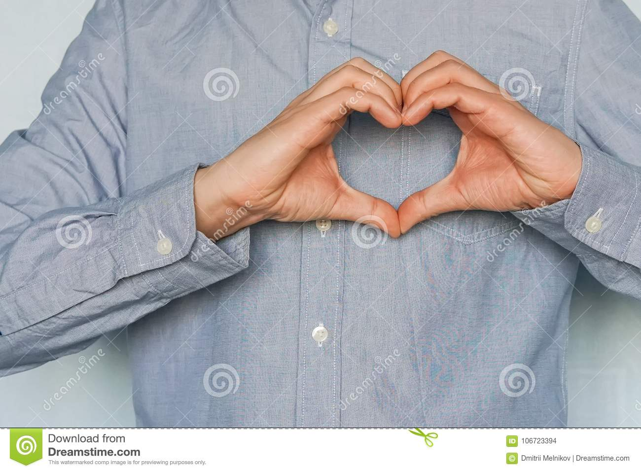 199300c0aed A symbol of love do hands. Valentine s day. A young man in love shows his  feelings. Businessman making a heart with his hands over white background