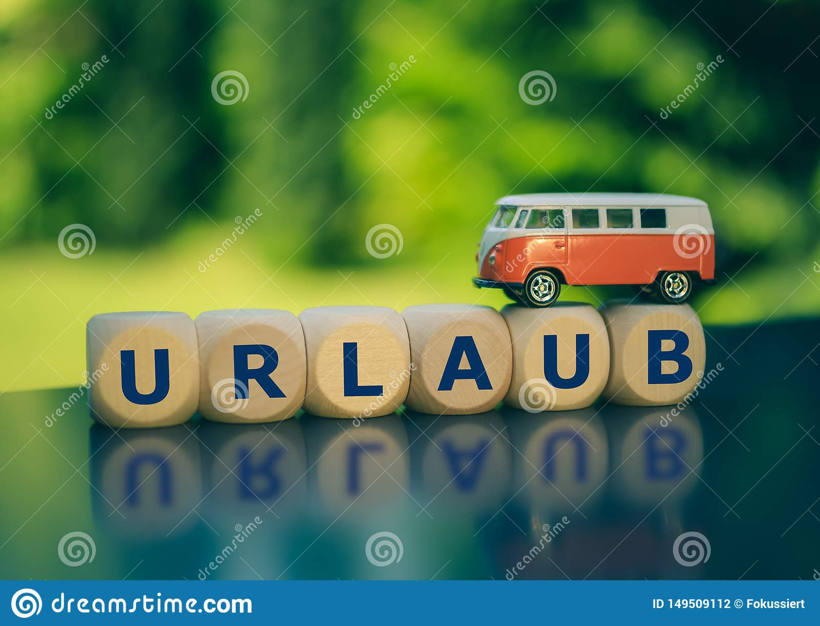 Symbol for summer holidays. Cubes form the German word `Urlaub` `vacation` in English