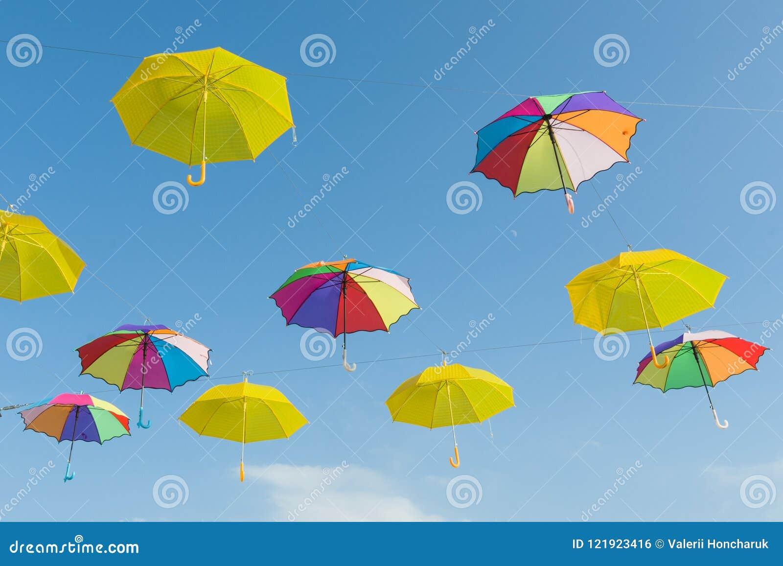 b7e10fa61 Symbol of summer, many open multi-colored umbrellas on sky background.
