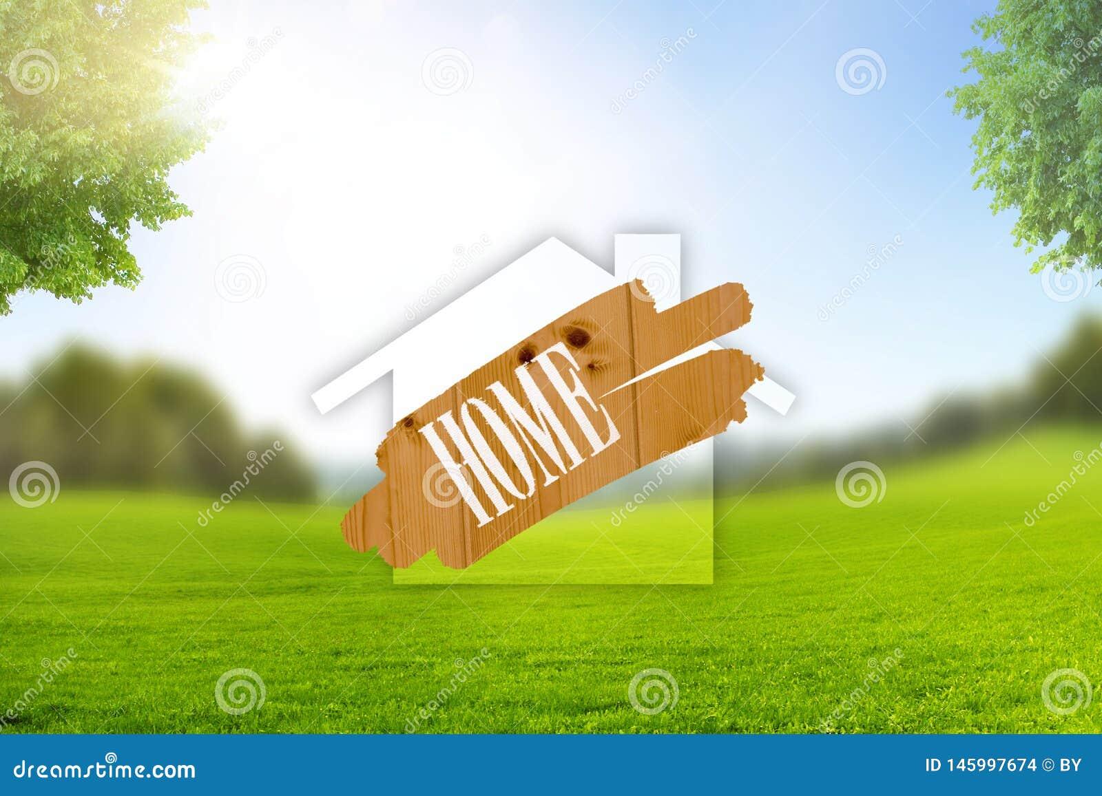 Symbole ? la maison dans le paysage avec le pr? vert