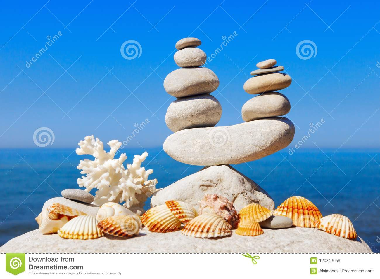 Symbolic Scales Of White Stones Shells And Coral On A Background Of