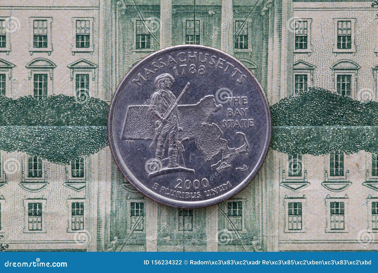Symmetric composition of US dollar bills and a quarter of Massachusetts
