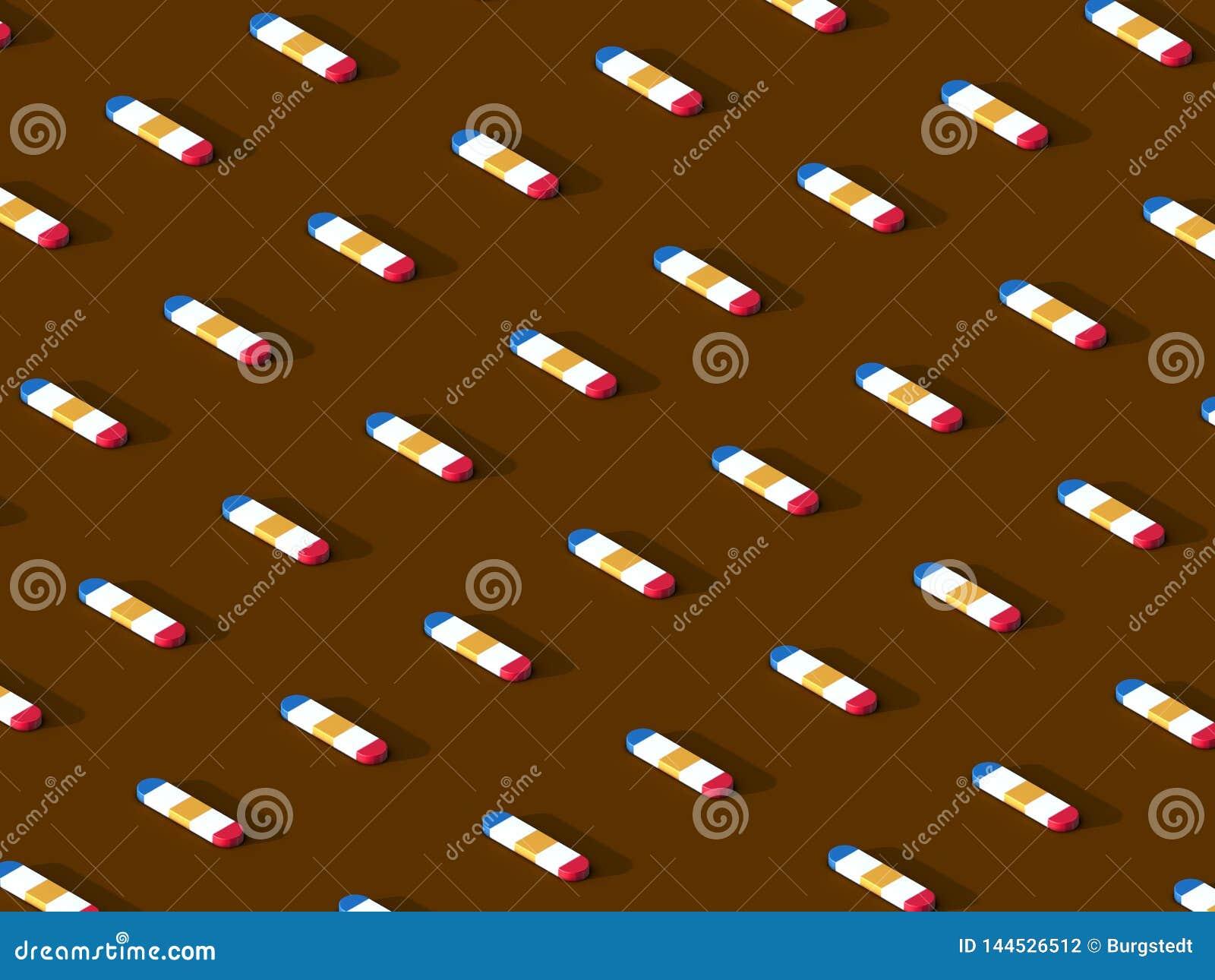 Symmetrically fördelade mångfärgade kapslar på brun bakgrund