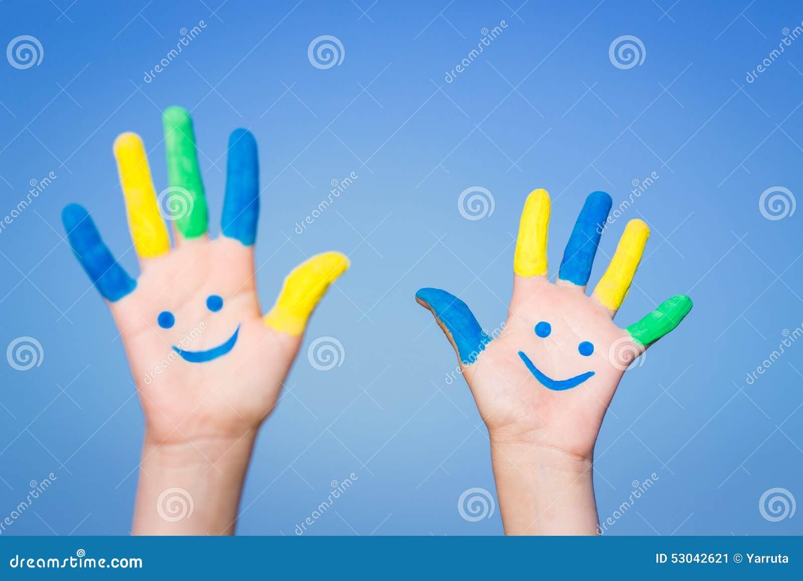 Szczęśliwe smiley ręki