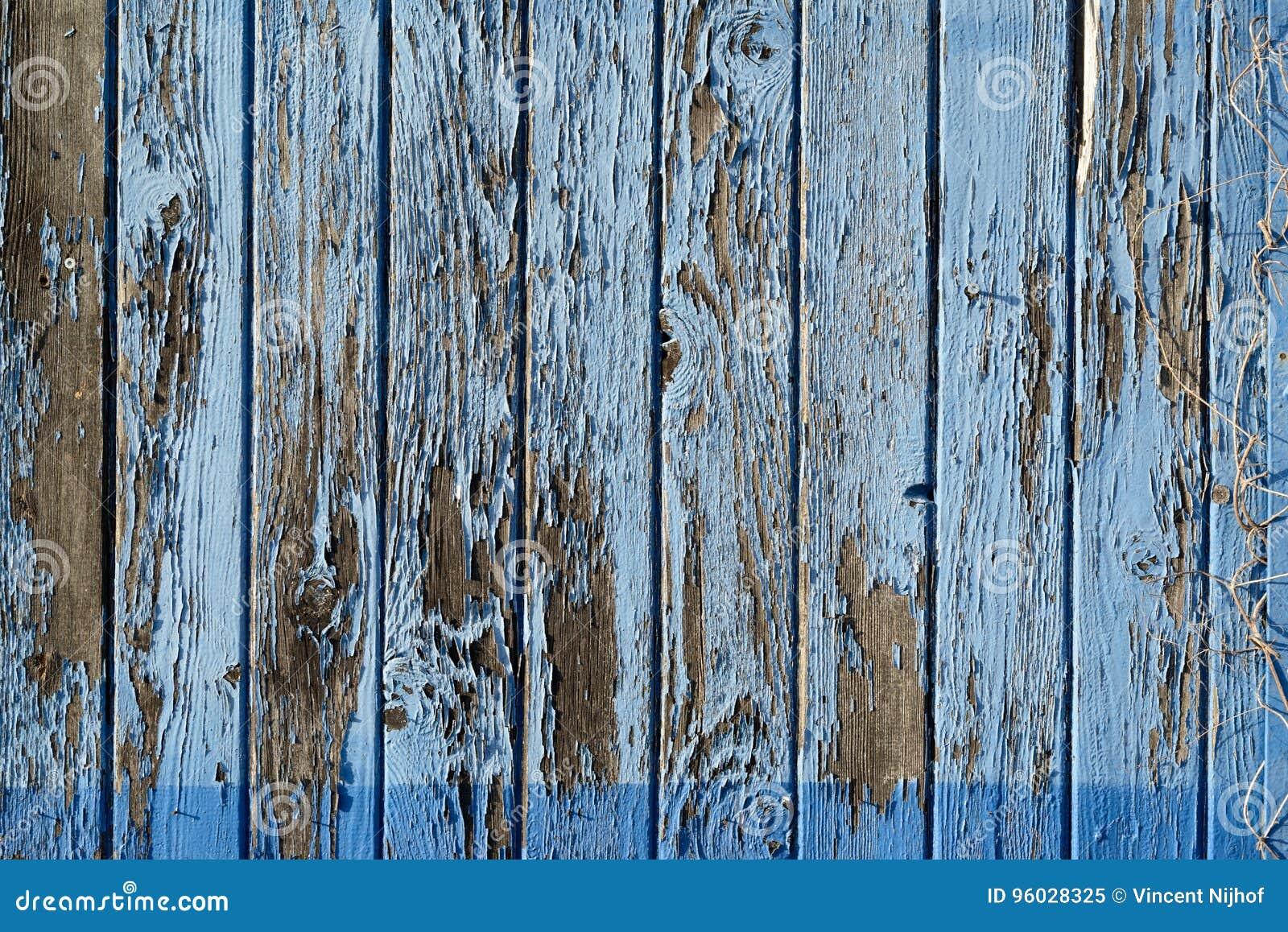 Szczegół gnijąca błękitna farba na drewnie