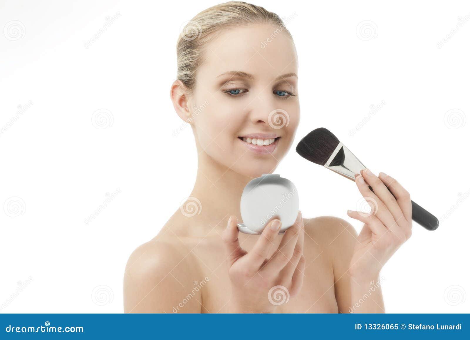 Szczotkarska lustra proszka kobieta