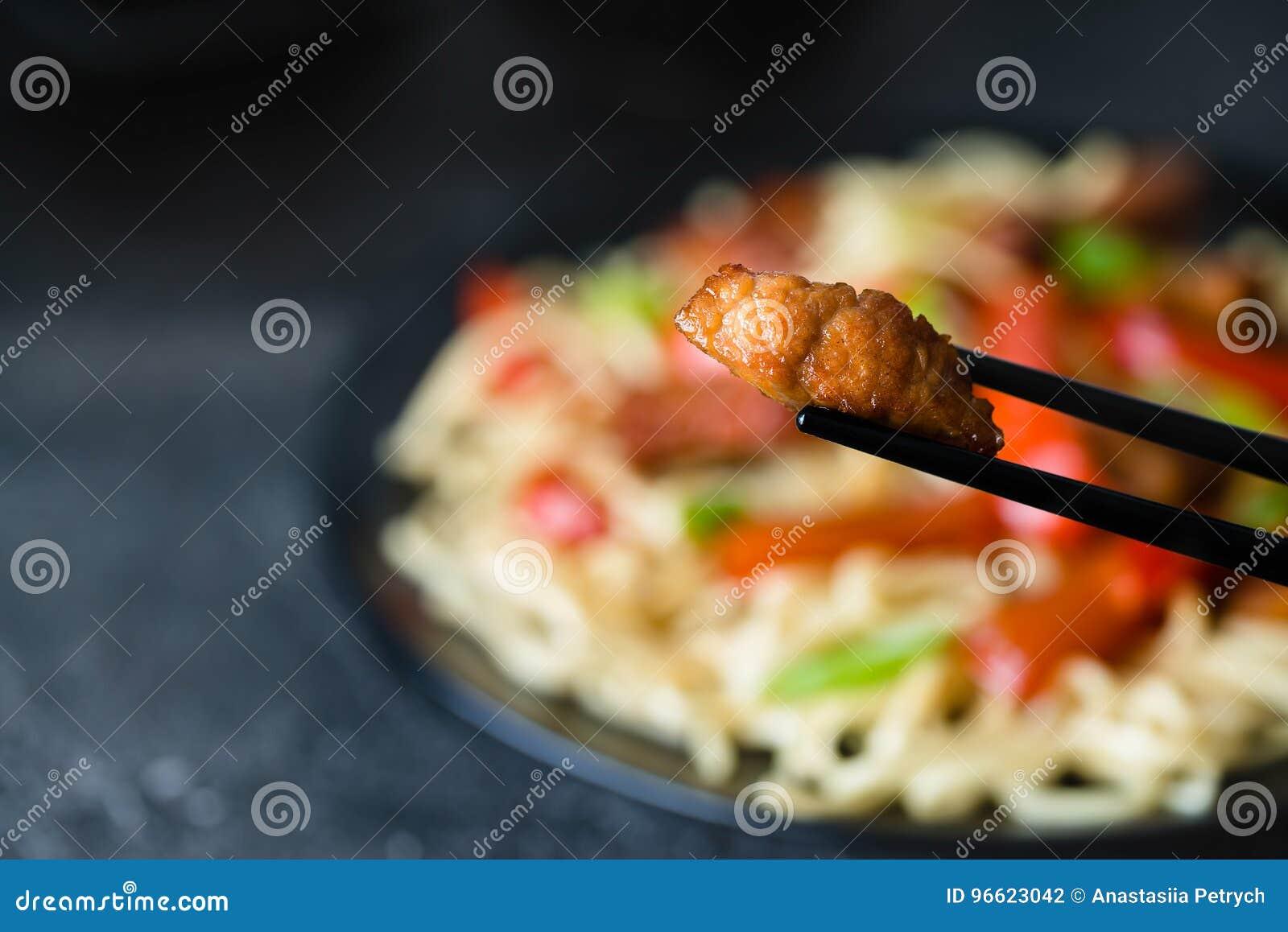 Szechuan Stir Fried Spicy Pork Hold With Chop Sticks