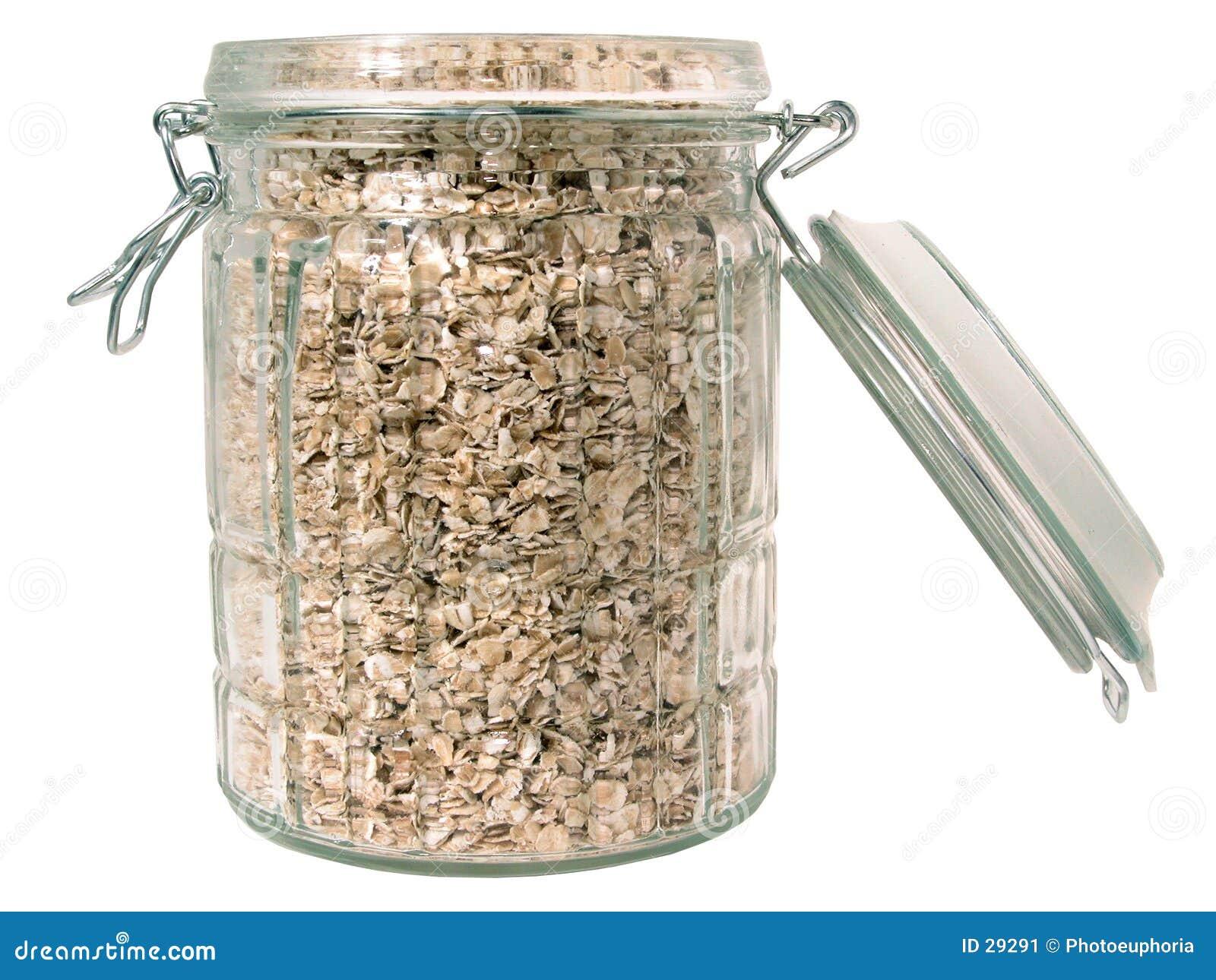Szkło odizolowane słojów jedzenie surowych owies