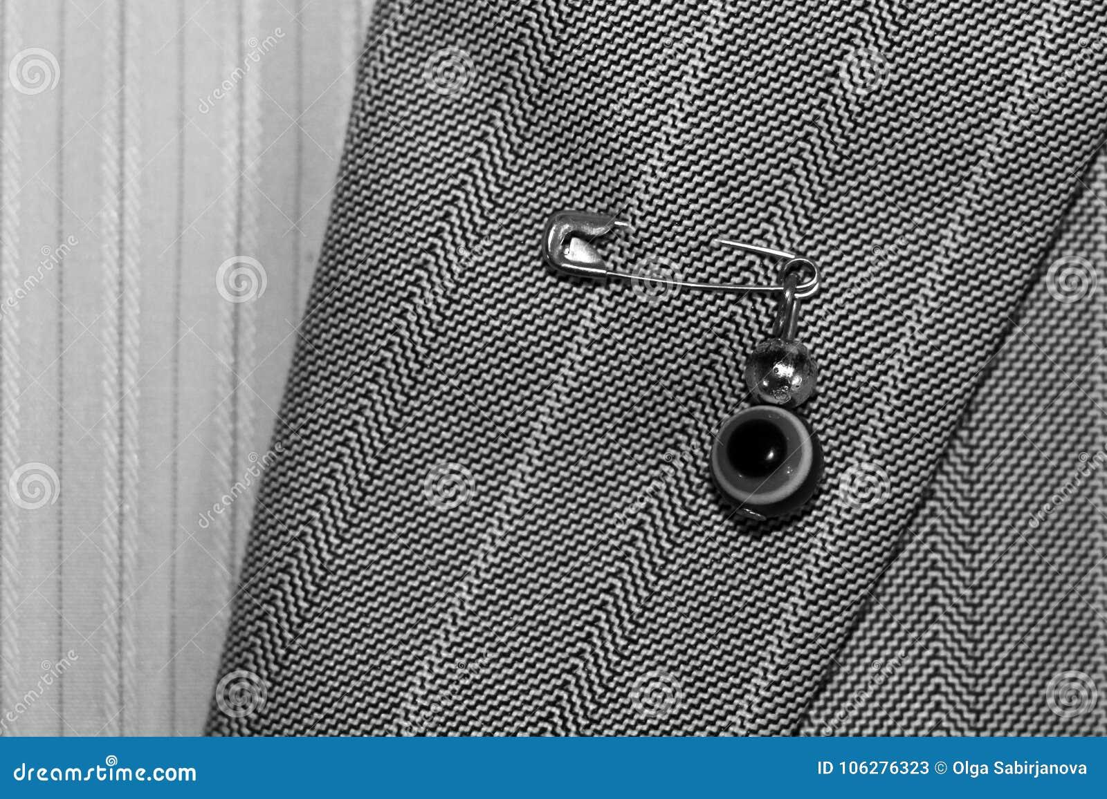 Szpilka od złego oka, ochrona osoby ` s odzież