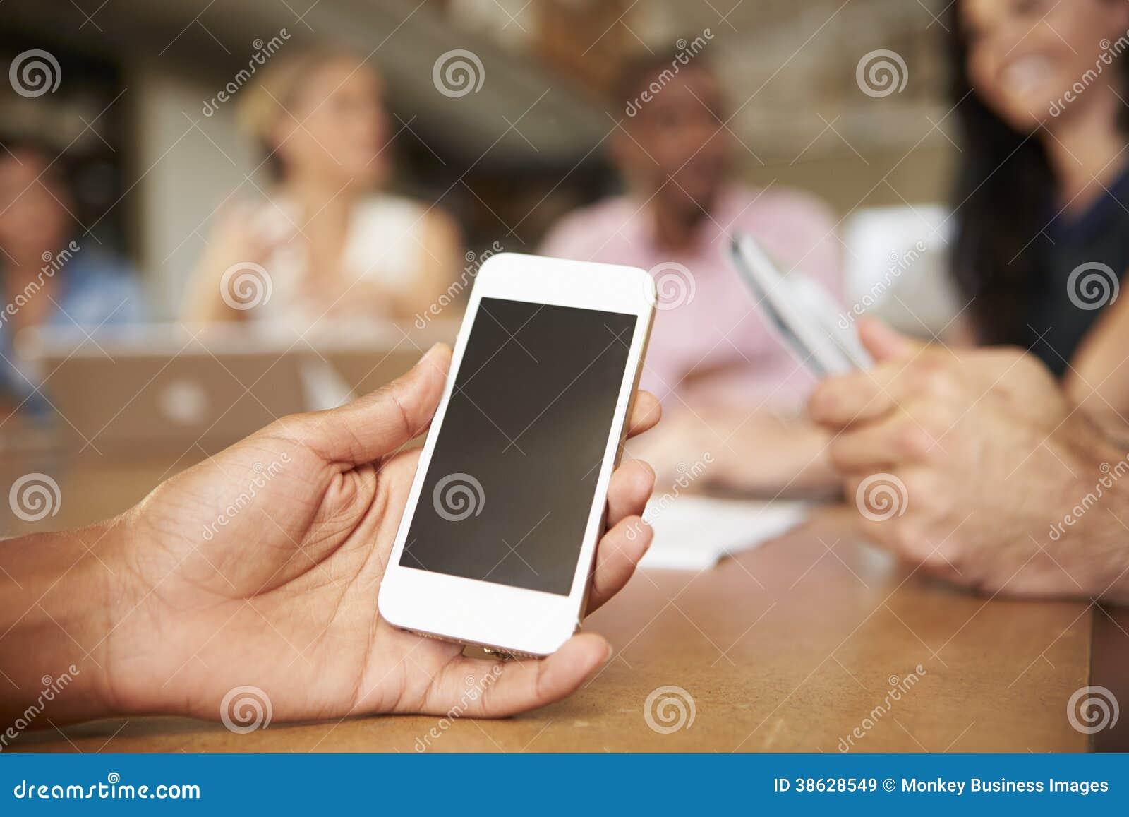 Téléphone portable employé par l architecte In Meeting