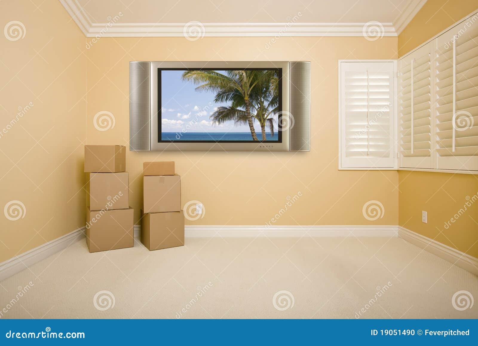 T l vision plate sur le mur dans la chambre vide avec des for Chambre vide