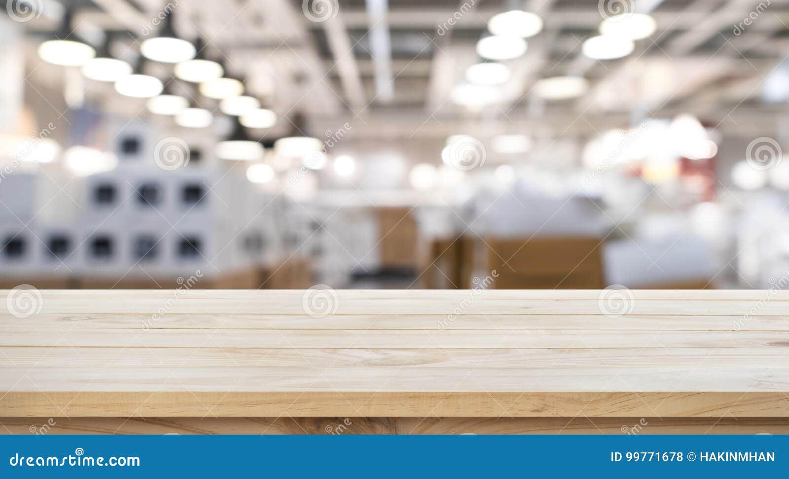 Töm av den wood tabellöverkanten på bakgrund för suddighetslagerfabrik