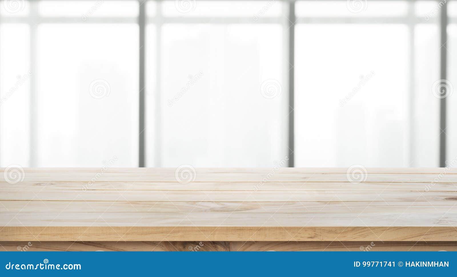 Töm av den wood tabellöverkanten på för fönsterkontor för suddighet stor bakgrund