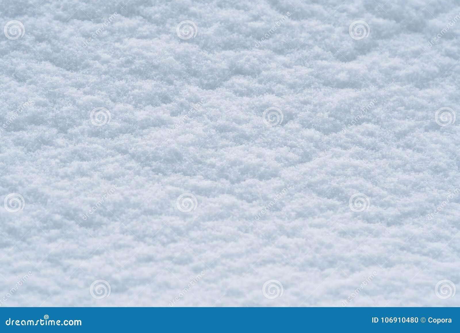 Tło śnieżna tekstura w błękitnym brzmieniu