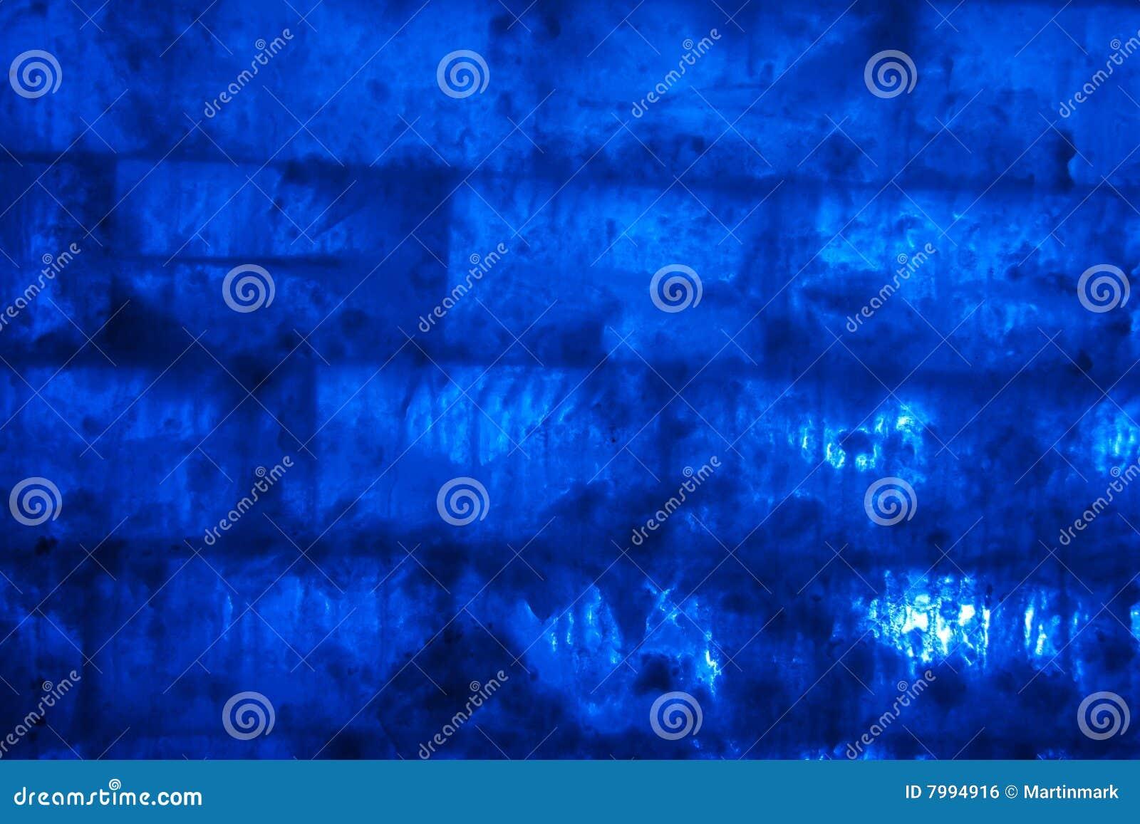 Tło cegły lodu błękitna ściana