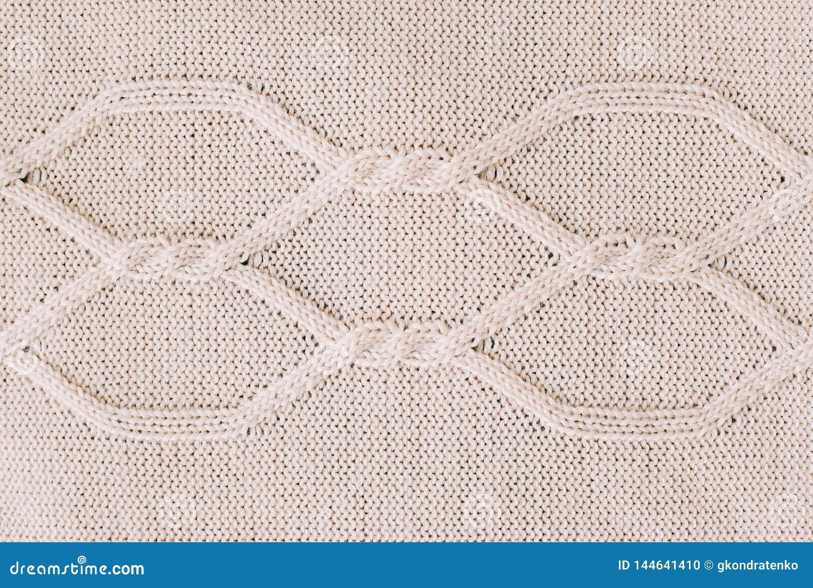 Tło dziający dziewiarski wzór wełna _ Tekstura trykotowa woolen tkanina dla tapetowego i abstrakcjonistycznego tła