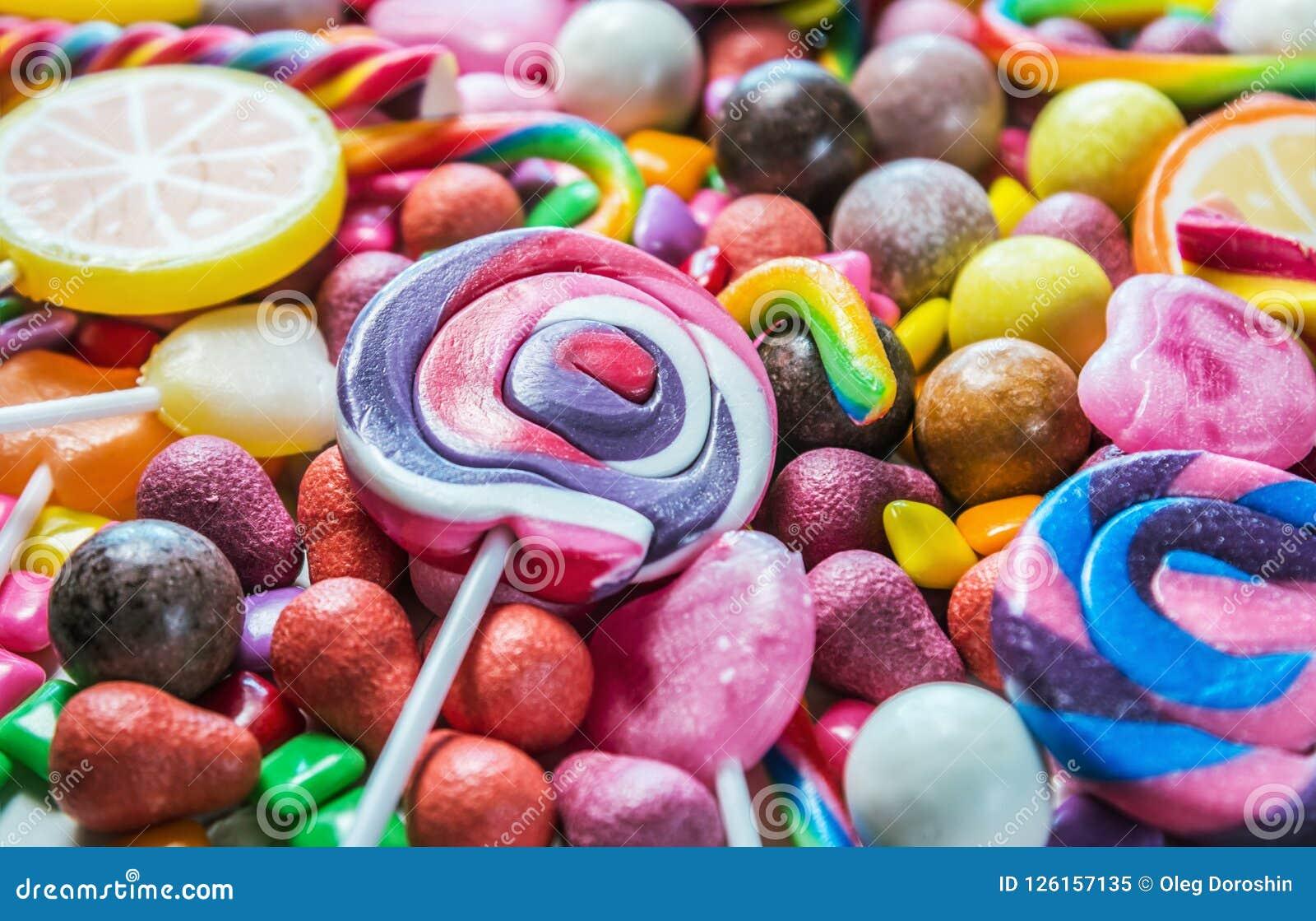 Tło od rozmaitości cukierki, lizaki, guma do żucia, candi