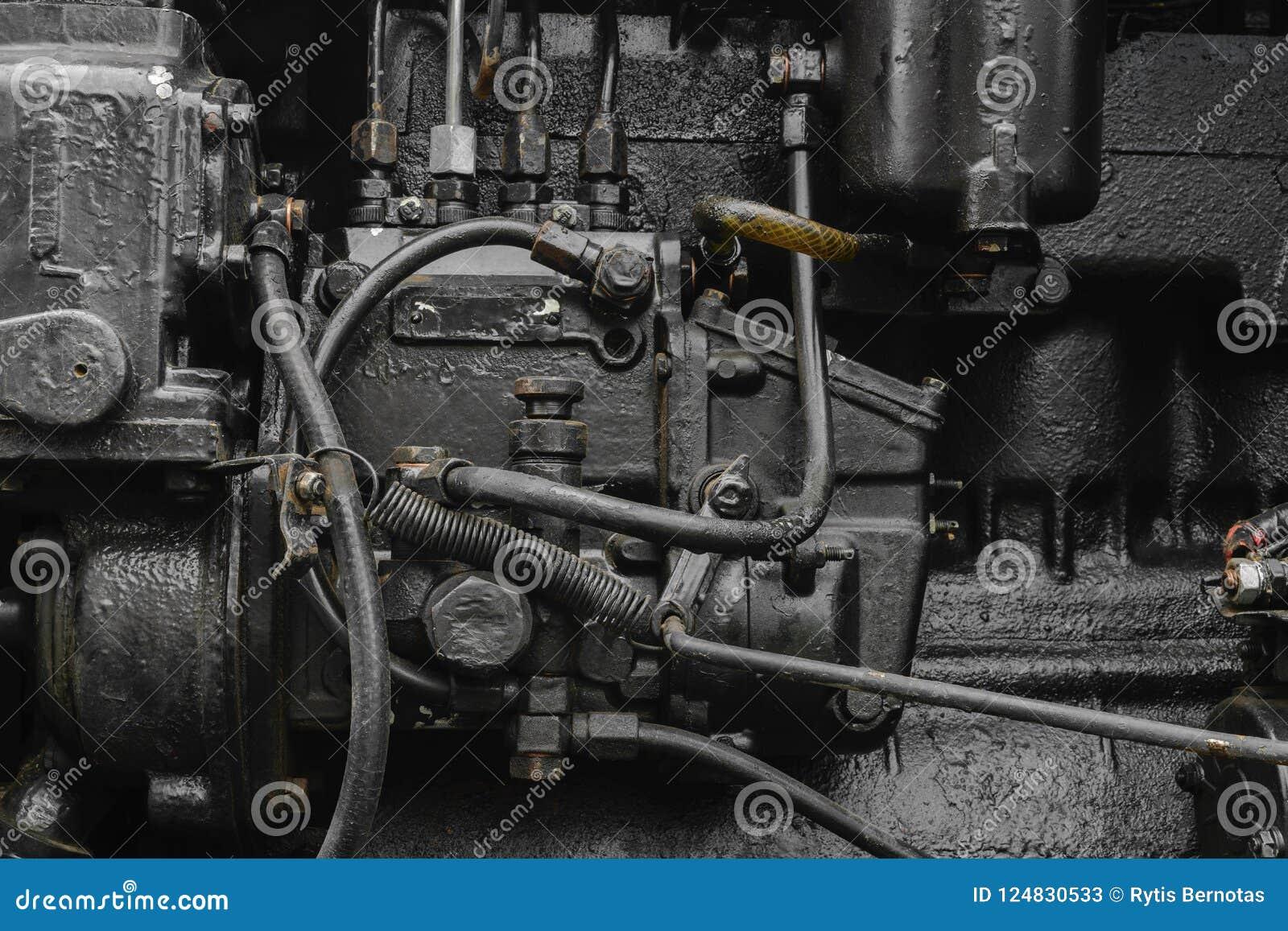 Tło powierzchnia stary, czarny i wazeliniarski maszynowy silnik,