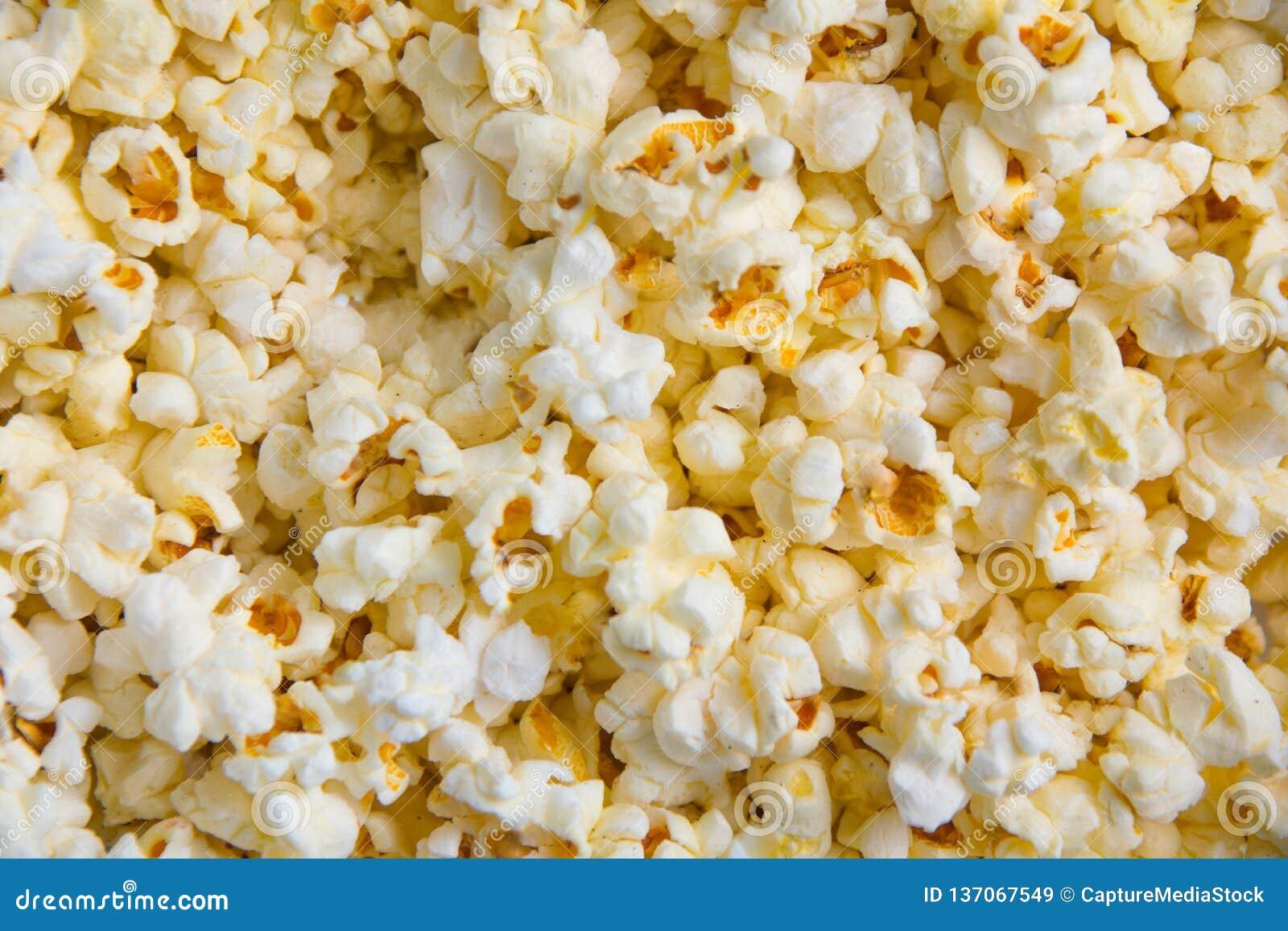 Tło smakowity masło popkorn biały kolor żółty
