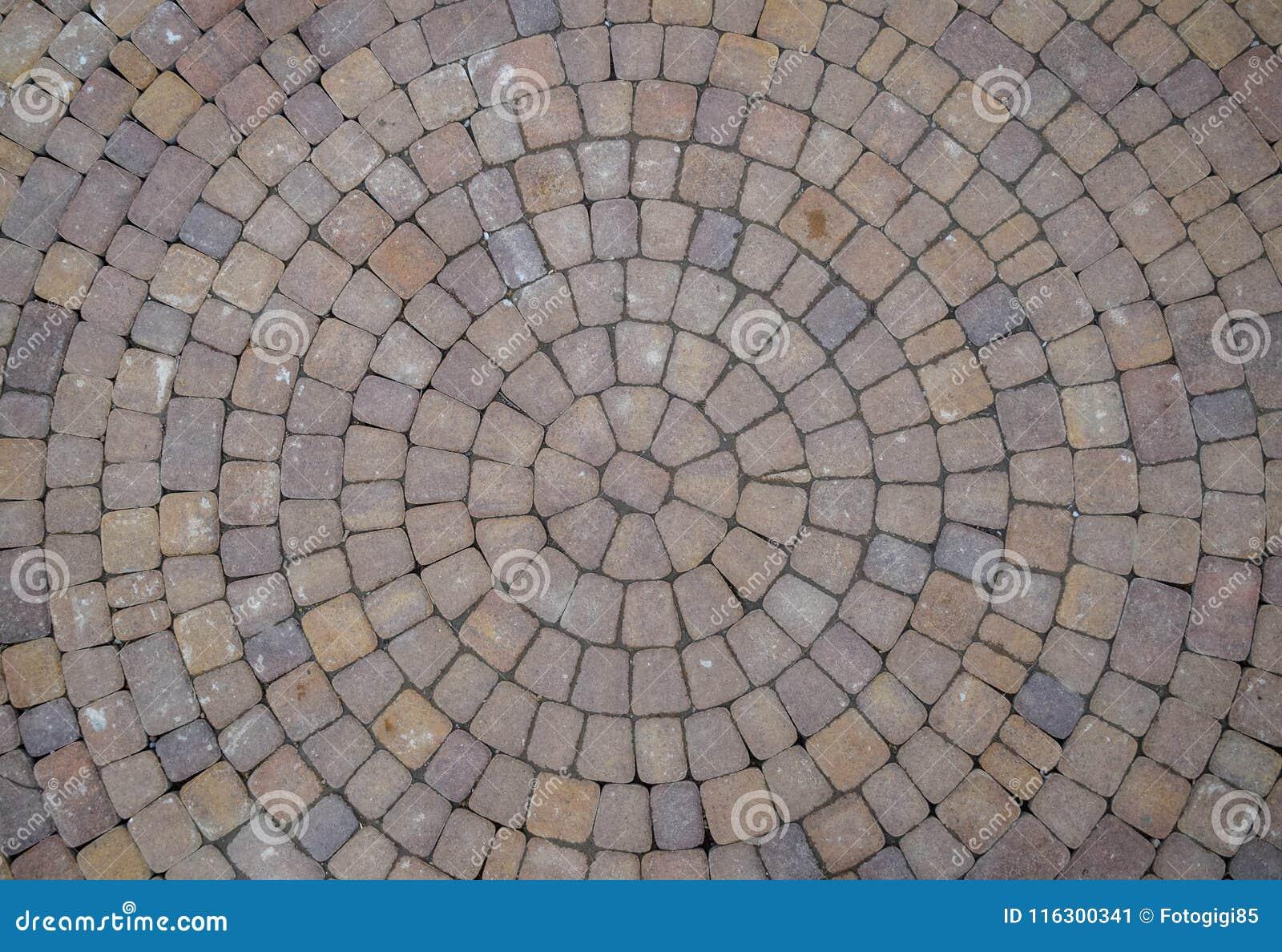 Tło tekstura brukowe cegiełki w okręgach
