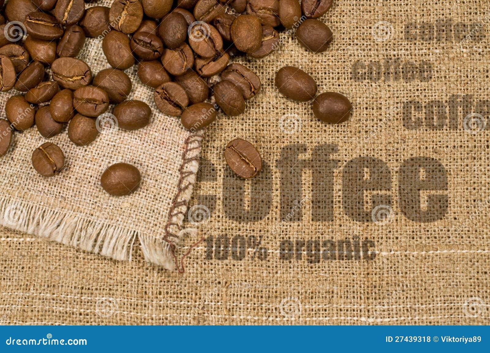 Tło z teksturą burlap i kawy fasole