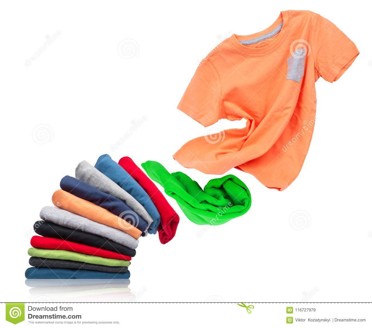 T-shirt flies out of a pile with clothes on white background