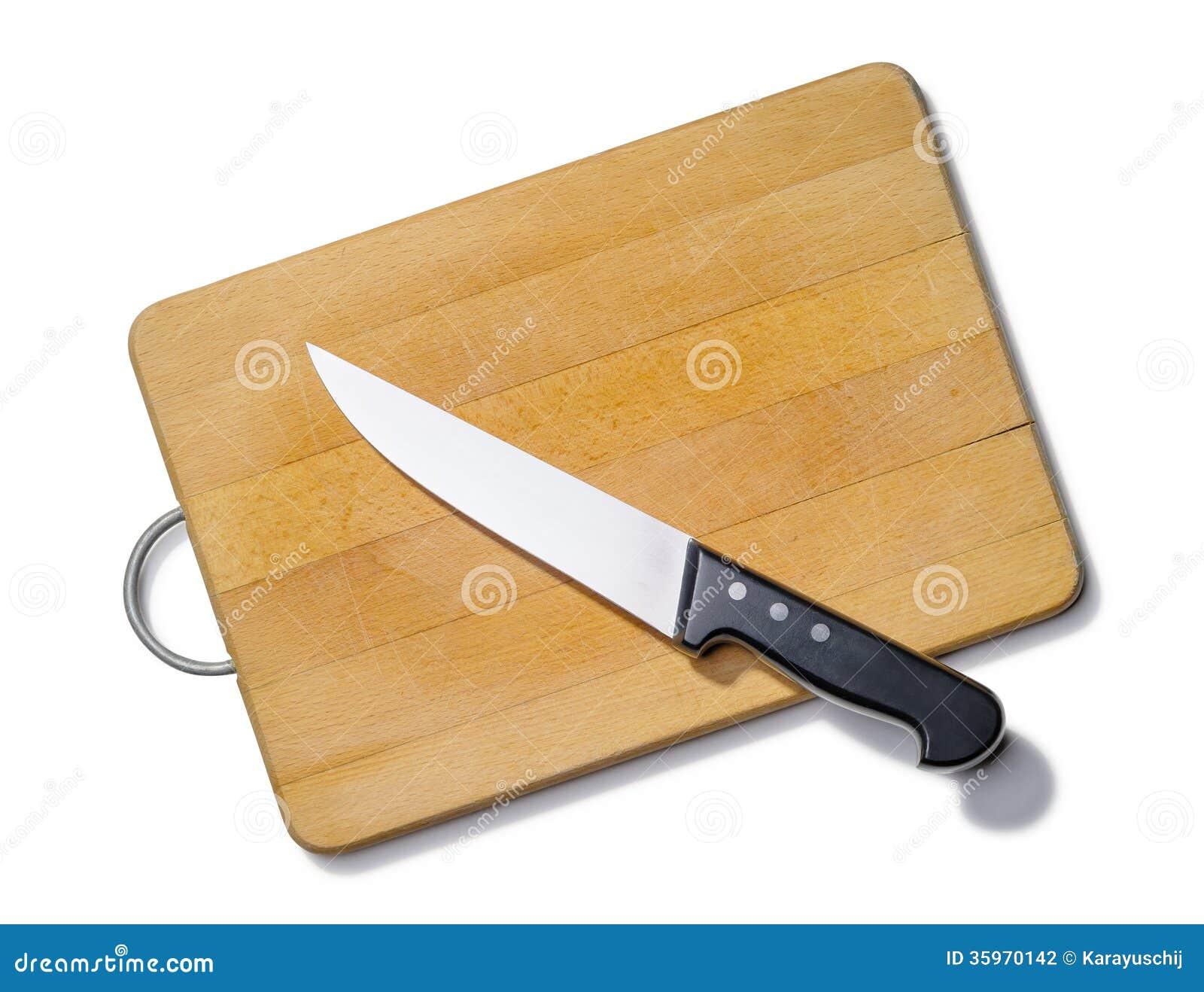 Tabla de cortar de madera con el cuchillo de cocina