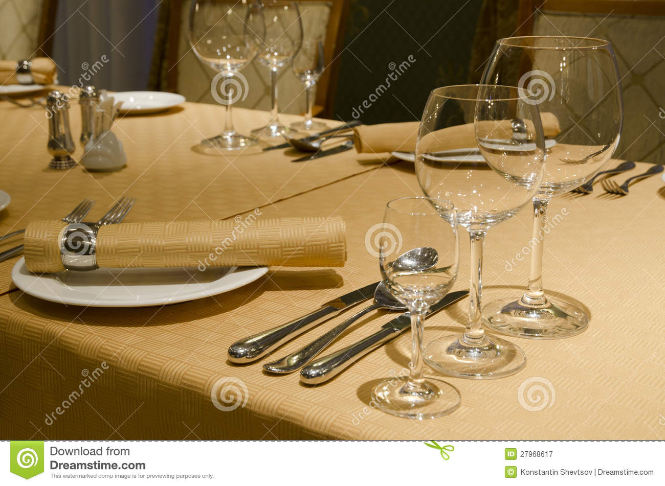 table appointments The lower edges of the utensils should be aligned with the bottom rim of the plate , about one (1) inch up from the edge of the table to avoid hiding a utensil.