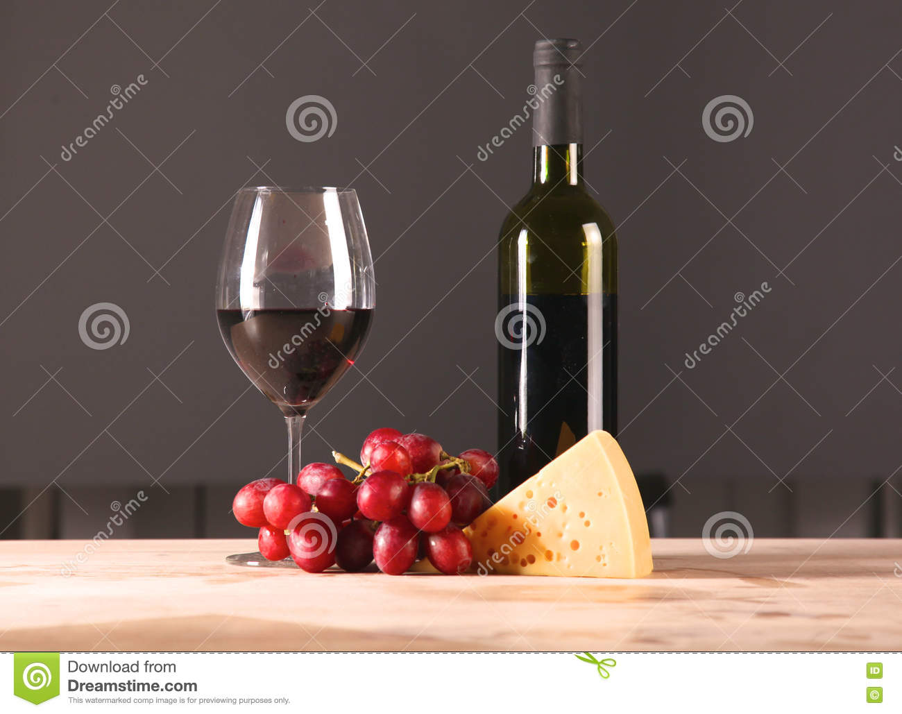 On the table a bottle of wine and a glass of