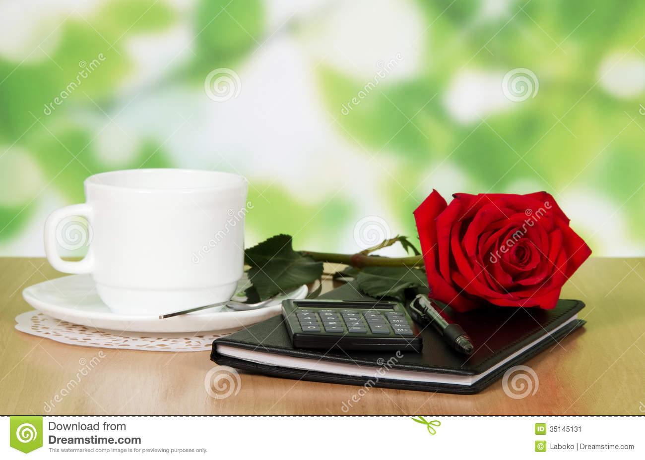 Table In Cafe With A Cup Of Coffee Rose And Stock Image