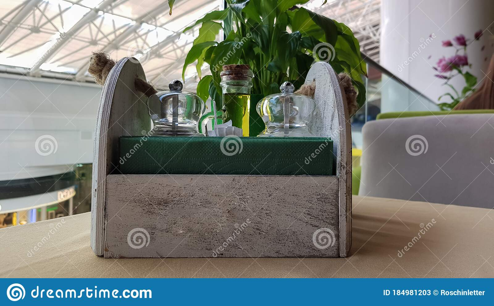 A Table In A Cafe Or Restaurant Napkins In A Wooden Napkin Holder Spices Salt And Pepper Olive Oil And Sauce On The Table Stock Image Image Of Modern Napkins 184981203